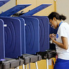 Don Knight | The Herald Bulletin<br /> Angel McClendon votes in her first election at Anderson Zion Baptist Church  on Tuesday.