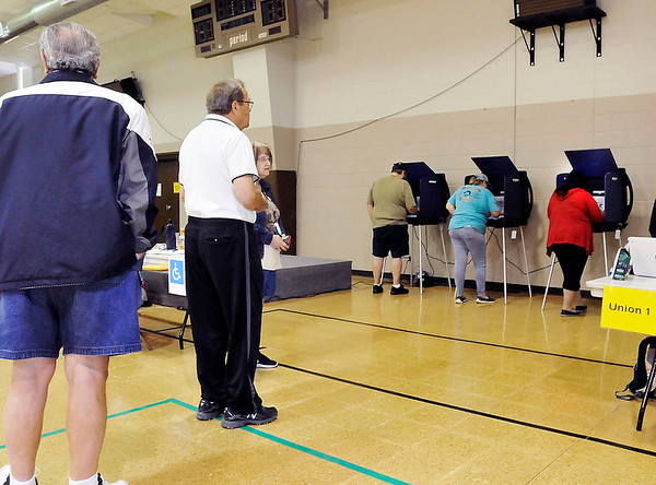 John P. Cleary   The Herald Bulletin<br /> Voters had to wait in line to vote Tuesday morning at Union Twp., Precinct 1 at Bethany Christian Church as the turnout has been steady all morning.