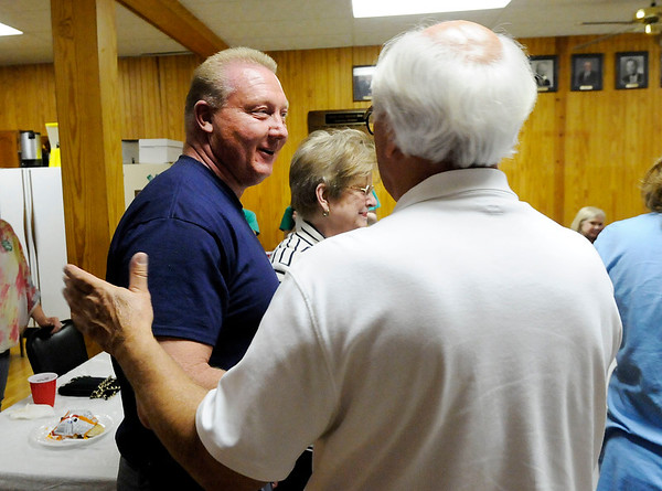 Don Knight   The Herald Bulletin<br /> Rick Muir congratulates State Senate Candidate Dave Cravens as he arrives at Democratic Headquarters on Tuesday.