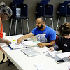 Don Knight | The Herald Bulletin<br /> Clerks Fresan Reese and Ben Smith check in Liz Perry at the polls at Anderson Zion Baptist Church on Tuesday.