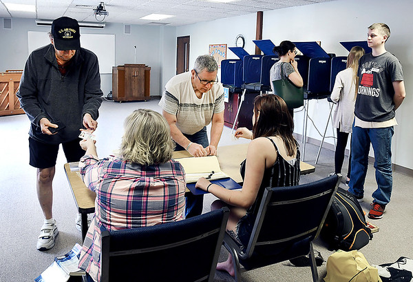 John P. Cleary | The Herald Bulletin <br /> Three voters was a rush for poll works at Anderson 1-6 located at East Side Church of God Tuesday morning as turnout for the primary so far has been very slow.