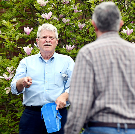 John P. Cleary | The Herald Bulletin <br /> Republican candidate for Anderson City Mayor Kevin Smith offers a voter some candy as he greets people at Anderson 5-3 Tuesday afternoon.