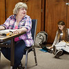 John P. Cleary | The Herald Bulletin <br /> The clerk at Anderson 1-6 looks up from her book to see what polling judge Beth Allen,18, is doing as the Lapel High School senior does her school work on the floor.