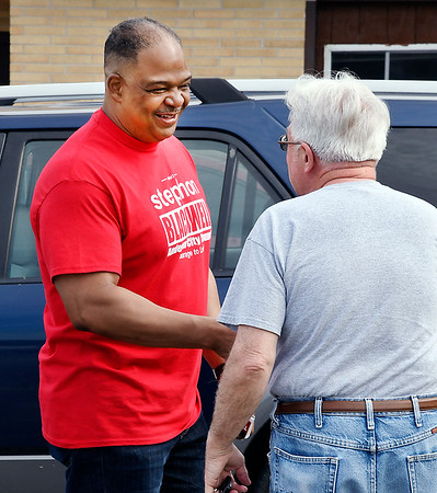 John P. Cleary | The Herald Bulletin <br /> Republican candidate for Anderson City Council District 1, Stephon Blackwell greets voters at the National Guard Armory voting site for Ward 1, Pcts, 1, 4, and 7 Tuesday morning.