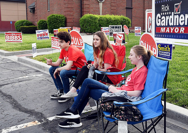 John P. Cleary | The Herald Bulletin <br /> These three Liberty Christian students, Nick Bitar,16, Ivory Wasson, 16, and Abigayle McCurry,17, were working the voting poll at East Side Church of God Tuesday morning supporting Republican Jennifer Culp for Anderson City Council District 1.
