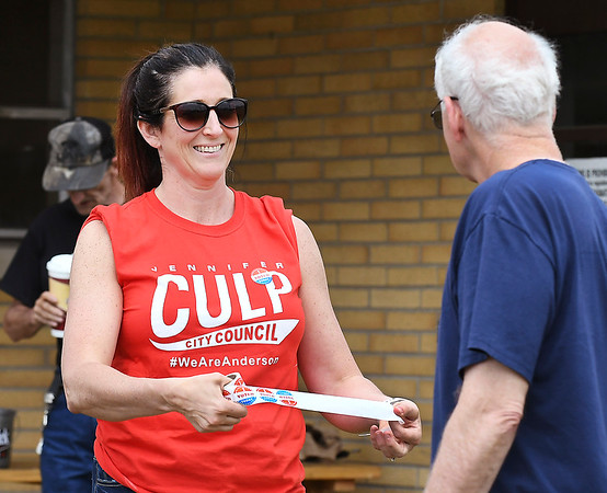 John P. Cleary | The Herald Bulletin <br /> Republican candidate for Anderson City Council District 1 Jennifer Culp offers voters a I Voted Today sticker as they leave the National Guard Armory voting site for Ward 1, Pct. 1,4, and 7 Tuesday.