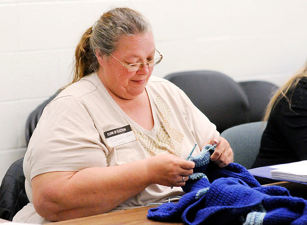Don Knight   The Herald Bulletin<br /> Election clerk Rhonda Hurt crochets while waiting for voters at the Central Services Building on Tuesday.