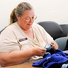 Don Knight | The Herald Bulletin<br /> Election clerk Rhonda Hurt crochets while waiting for voters at the Central Services Building on Tuesday.