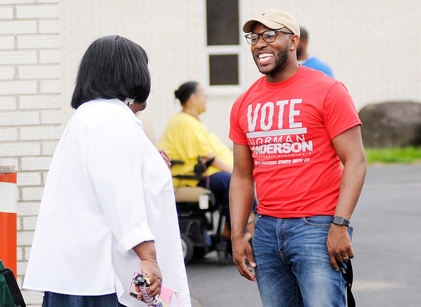 Don Knight   The Herald Bulletin<br /> Norman Anderson Jr. talks to voters outside the polls at Anderson Zion Baptist Church on Tuesday.