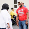 Don Knight | The Herald Bulletin<br /> Norman Anderson Jr. talks to voters outside the polls at Anderson Zion Baptist Church on Tuesday.