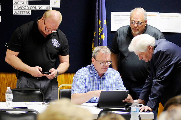 Don Knight   The Herald Bulletin<br /> From left, Dave Cravens, David Eicks, Ed Leonard and Anderson Mayor Thomas Broderick Jr. check results as they start to come into the Democratic Party Headquarters on Tuesday.