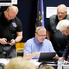 Don Knight | The Herald Bulletin<br /> From left, Dave Cravens, David Eicks, Ed Leonard and Anderson Mayor Thomas Broderick Jr. check results as they start to come into the Democratic Party Headquarters on Tuesday.