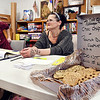 John P. Cleary | The Herald Bulletin <br /> Polling clerk Ethan Smith and Leanne King wait for voters to show at Anderson 6-3 at Fifth Street United Methodist Church as King baked fresh cookies for the voters and her co-workers for election day.