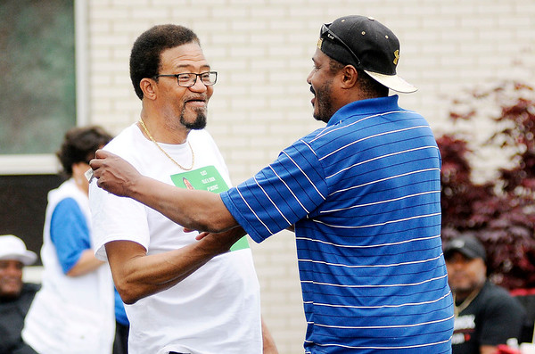 Don Knight | The Herald Bulletin<br /> Ollie Dixon talks to voters outside the polls at Anderson Zion Baptist Church  on Tuesday.
