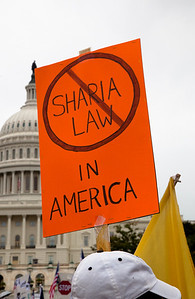 Home made signs, some with anti-Muslem themes, were abundant as Tea Partiers gather around the West Lawn of the US Capitol in Washington DC for a second 9/12 rally on September 12, 2010. (Photo by Jeff Malet)