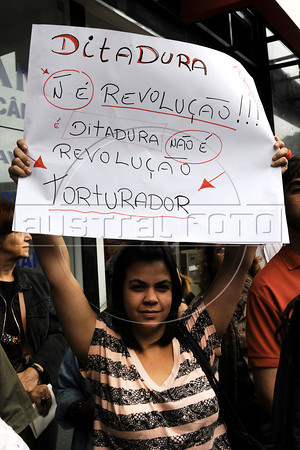 """Politic activists shout """"torturer"""" and """"murderer,"""" at retired military men arriving at a military club in downtown to celebrate the anniversary of 1964 military coup, Rio de Janeiro, Brazil, March 29, 2012. A club of retired military officers celebrates annualy lheld the Brazil's 1964 military coup, but faced protestors as members arrived for the event. (Austral Foto/Renzo Gostoli)"""