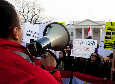 "Several hundred demonstrators demanding that Egyptian President Hosni Mubarak vacate his office gathered outside the White House for a planned march to Capitol Hill in Washington DC on Friday, February 4, 2011. Mubarak has been head of government in Egypt for 30 years. In recent days, thousands of Egyptians have poured into the streets of several cities to call for a change in government. Here chanting slogans such as ""Egypt, Egypt, raise your voice .. It's our time, it's our choice""  (Photo by Jeff Malet)"