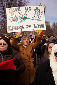 """Give us a chance to live"". Hundreds of demonstrators gathered in front of the White House calling on the United States to do more to help liberate Arab nations. The protestors stood in solidarity with pro-democracy movements taking place in Yemen, Bahrain, Libya, Iraq, Iran and the Sudan. In Washington DC on Saturday, February 26, 2011. (Photo by Jeff Malet)"