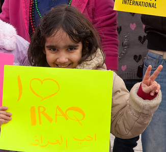 Baraa (age 7) is among a group of Iraqi nationals living in the Washington DC area standing in front of the White House to protest corruption in the Iraqi government. Hundreds of demonstrators gathered in front of the White House calling on the United States to do more to help liberate Arab nations. The protestors stood in solidarity with pro-democracy movements taking place in Yemen, Bahrain, Libya, Iraq, Iran and the Sudan. In Washington DC on Saturday, February 26, 2011. (Photo by Jeff Malet)