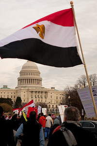 The Egyptian flag was evident as several hundred demonstrators demanding that Egyptian President Hosni Mubarak vacate his office, march down Pennsylvania Ave. from the White House to the Capitol (in photo), in Washington DC on Friday, February 4, 2011. Mubarak has been head of government in Egypt for 30 years. In recent days, thousands of Egyptians have poured into the streets of several cities to call for a change in government. (Photo by Jeff Malet)