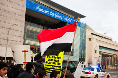 Several hundred demonstrators demanding that Egyptian President Hosni Mubarak vacate his office, march down Pennsylvania Ave. from the White House to the Capitol, in Washington DC on Friday, February 4, 2011. Mubarak has been head of government in Egypt for 30 years. In recent days, thousands of Egyptians have poured into the streets of several cities to call for a change in government. In the rear of the photo, the Newseum and its giant representation of the 1st (free speech) Amendment to the Constitution. (Photo by Jeff Malet)