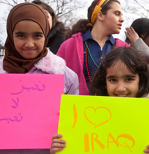 Israa (age 10) and Baraa (age 7) are among a group of Iraqi nationals living in the Washington DC area standing in front of the White House to protest corruption in the Iraqi government. Hundreds of demonstrators gathered in front of the White House calling on the United States to do more to help liberate Arab nations. The protestors stood in solidarity with pro-democracy movements taking place in Yemen, Bahrain, Libya, Iraq, Iran and the Sudan. In Washington DC on Saturday, February 26, 2011. (Photo by Jeff Malet)