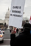 Several hundred demonstrators demanding that Egyptian President Hosni Mubarak vacate his office, march down Pennsylvania Ave. from the White House to the Capitol, in Washington DC on Friday, ...