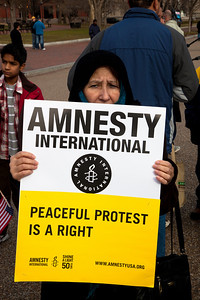 """Peaceful Protest is a Right"". Hundreds of demonstrators gathered in front of the White House calling on the United States to do more to help liberate Arab nations. The protestors stood in solidarity with pro-democracy movements taking place in Libya, Yemen, Bahrain, Iraq, Iran and the Sudan. In Washington DC on Saturday, February 26, 2011. (Photo by Jeff Malet)"