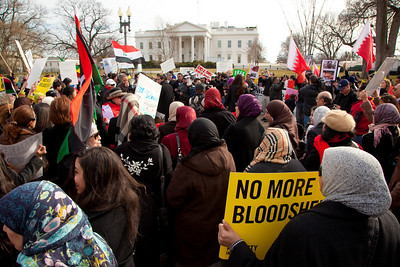 Hundreds of demonstrators gathered in front of the White House calling on the United States to do more to help liberate Arab nations. The protestors stood in solidarity with pro-democracy movements taking place in Libya, Yemen, Bahrain, Iraq, Iran and the Sudan. In Washington DC on Saturday, February 26, 2011. (Photo by Jeff Malet)