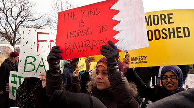 """The King is insane in Bahrain"". Hundreds of demonstrators gathered in front of the White House calling on the United States to do more to help liberate Arab nations. The protestors stood in solidarity with pro-democracy movements taking place in Libya, Yemen, Bahrain, Iraq, Iran and the Sudan. In Washington DC on Saturday, February 26, 2011. (Photo by Jeff Malet)"