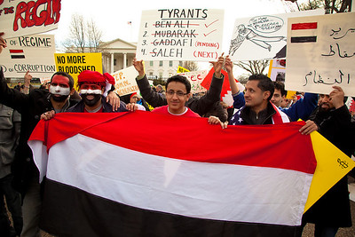 Protestors holding the flag of Yemen. Hundreds of demonstrators gathered in front of the White House calling on the United States to do more to help liberate Arab nations. The protestors stood in solidarity with pro-democracy movements taking place in Libya, Yemen, Bahrain, Iraq, Iran and the Sudan. In Washington DC on Saturday, February 26, 2011. (Photo by Jeff Malet)