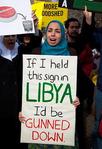 """If I held this sign in Libya, I'd be gunned down"". Hundreds of demonstrators gathered in front of the White House calling on the United States to do more to help liberate Arab nations. The protestors stood in solidarity with pro-democracy movements taking place in Libya, Yemen, Bahrain, Iraq, Iran and the Sudan. In Washington DC on Saturday, February 26, 2011. (Photo by Jeff Malet)"