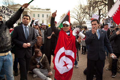 Hundreds of demonstrators gathered in front of the White House calling on the United States to do more to help liberate Arab nations. The protestors stood in solidarity with pro-democracy movements taking place in Yemen, Bahrain, Libya, Iraq, Iran and the Sudan. In Washington DC on Saturday, February 26, 2011. (Photo by Jeff Malet)