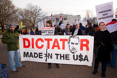 "Several hundred demonstrators demanding that ""dictator"" Egyptian President Hosni Mubarak vacate his office gathered outside the White House for a planned march to Capitol Hill in Washington DC on Friday, February 4, 2011. Mubarak has been head of government in Egypt for 30 years. In recent days, thousands of Egyptians have poured into the streets of several cities to call for a change in government. (Photo by Jeff Malet)"