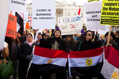 Several hundred demonstrators demanding that Egyptian President Hosni Mubarak vacate his office gathered outside the White House for a planned march to Capitol Hill in Washington DC on Friday, February 4, 2011. Many were waving the Egyptian flag. Mubarak has been head of government in Egypt for 30 years. In recent days, thousands of Egyptians have poured into the streets of several cities to call for a change in government. (Photo by Jeff Malet)
