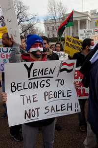 """Yemen Belongs to the People, Not Saleh"". Hundreds of demonstrators gathered in front of the White House calling on the United States to do more to help liberate Arab nations. The protestors stood in solidarity with pro-democracy movements taking place in Libya, Yemen, Bahrain, Iraq, Iran and the Sudan. In Washington DC on Saturday, February 26, 2011. (Photo by Jeff Malet)"