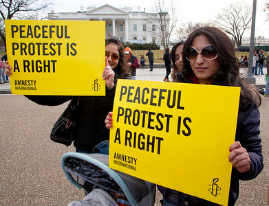 "Hundreds of demonstrators gathered in front of the White House calling on the United States to do more to help liberate Arab nations. The protestors stood in solidarity with pro-democracy movements taking place in Yemen, Bahrain, Libya, Iraq, Iran and the Sudan. In Washington DC on Saturday, February 26, 2011. In photo, signs read ""Peaceful Protest is a Right"".  (Photo by Jeff Malet)"