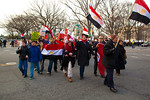 Several hundred demonstrators demanding that Egyptian President Hosni Mubarak vacate his office begin their march from the White House to the Capitol, turning onto Pennsylvania Ave. in Washi ...