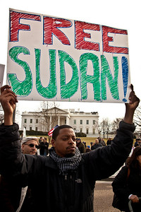 """Free Sudan"". Hundreds of demonstrators gathered in front of the White House calling on the United States to do more to help liberate Arab nations. The protestors stood in solidarity with pro-democracy movements taking place in Libya, Yemen, Bahrain, Iraq, Iran and the Sudan. In Washington DC on Saturday, February 26, 2011. (Photo by Jeff Malet)"
