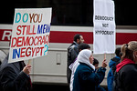 Several hundred demonstrators demanding that Egyptian President Hosni Mubarak vacate his office, march past a DC Metro bus down Pennsylvania Ave. from the White House to the Capitol, in Wash ...