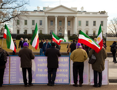 Iranian activists set up a wall of signs in front of the White House, chanting down with President Mahmoud Ahmadinejad and calling for the United States to support Iran's resistance. Hundreds of demonstrators gathered in front of the White House calling on the United States to do more to help liberate Arab nations. The protestors stood in solidarity with pro-democracy movements taking place in Yemen, Bahrain, Libya, Iraq, Iran and the Sudan. In Washington DC on Saturday, February 26, 2011. (Photo by Jeff Malet)