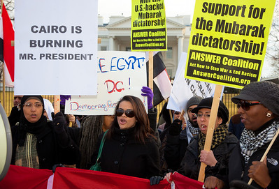 "Several hundred demonstrators demanding that Egyptian President Hosni Mubarak vacate his office gathered outside the White House for a planned march to Capitol Hill in Washington DC on Friday, February 4, 2011. Mubarak has been head of government in Egypt for 30 years. In recent days, thousands of Egyptians have poured into the streets of several cities to call for a change in government. Sign says ""Cairo is Burning Mr. Presdient"". (Photo by Jeff Malet)"