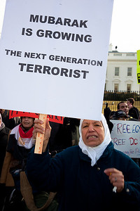 "Several hundred demonstrators demanding that Egyptian President Hosni Mubarak vacate his office gathered outside the White House for a planned march to Capitol Hill in Washington DC on Friday, February 4, 2011. Mubarak has been head of government in Egypt for 30 years. In recent days, thousands of Egyptians have poured into the streets of several cities to call for a change in government. Here chanting in Arabic ""Wake up wake up Mubarak, today is the last day"". Sign reads ""Mubarak is Growing The Next Generation Terrorist"".  (Photo by Jeff Malet)"