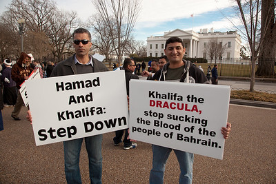 Protestor holds up poster referring to Bahrain King Hamad Bin Isa al Khalifa as a blood sucking Dracula . Hundreds of demonstrators gathered in front of the White House calling on the United States to do more to help liberate Arab nations. The protestors stood in solidarity with pro-democracy movements taking place in Yemen, Bahrain, Libya, Iraq, Iran and the Sudan. In Washington DC on Saturday, February 26, 2011. (Photo by Jeff Malet)