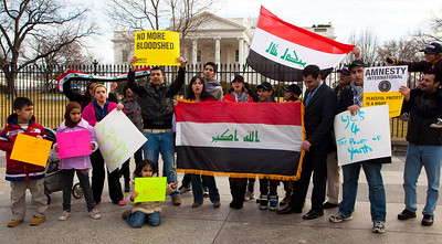 Iraqi nationals living in the Washington DC area display Iraqi flag in front of the White House to protest corruption in the Iraqi government. Hundreds of demonstrators gathered in front of the White House calling on the United States to do more to help liberate Arab nations. The protestors stood in solidarity with pro-democracy movements taking place in Yemen, Bahrain, Libya, Iraq, Iran and the Sudan. In Washington DC on Saturday, February 26, 2011. (Photo by Jeff Malet)