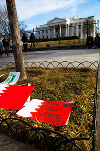 "Hundreds of demonstrators gathered in front of the White House calling on the United States to do more to help liberate Arab nations. The protestors stood in solidarity with pro-democracy movements taking place in Yemen, Bahrain, Libya, Iraq, Iran and the Sudan. In Washington DC on Saturday, February 26, 2011. Protest sign is a picture of the flag of Bahrain with the words ""Speak out even if your voice shakes"". (Photo by Jeff Malet)"