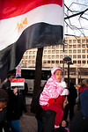 Child holding Egyptian flag. Several hundred demonstrators demanding that Egyptian President Hosni Mubarak vacate his office, march down Pennsylvania Ave. from the White House to the Capitol ...