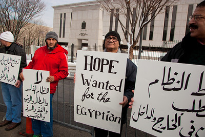 """Demonstrators  demanding that Egyptian President Hosni Mubarak vacate his office gathered outside the Egyptian Embassy to the United States in Washington DC on Sunday, January 30, 2011. Mubarak has been head of government in Egypt for 30 years. In recent days, thousands of Egyptians have poured into the streets of several cities to call for a change in government. On sign says """"Hope Wanted for the Egyptians"""".  (Photo by Jeff Malet)"""