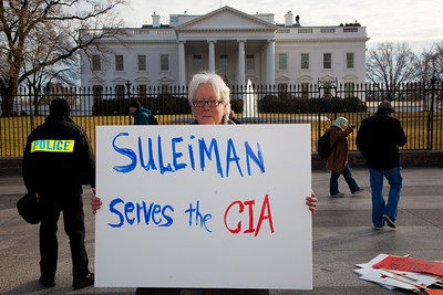 "Several hundred demonstrators demanding that Egyptian President Hosni Mubarak vacate his office gathered outside the White House for a planned march to Capitol Hill in Washington DC on Friday, February 4, 2011. Mubarak has been head of government in Egypt for 30 years. In recent days, thousands of Egyptians have poured into the streets of several cities to call for a change in government. Sign reads ""Suleiman Serves the CIA"" referring to the Egyptian Vice President. (Photo by Jeff Malet)"