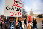Several hundred demonstrators demanding that Egyptian President Hosni Mubarak vacate his office, march past the Capitol, in Washington DC on Friday, February 4, 2011. Mubarak has been head o ...
